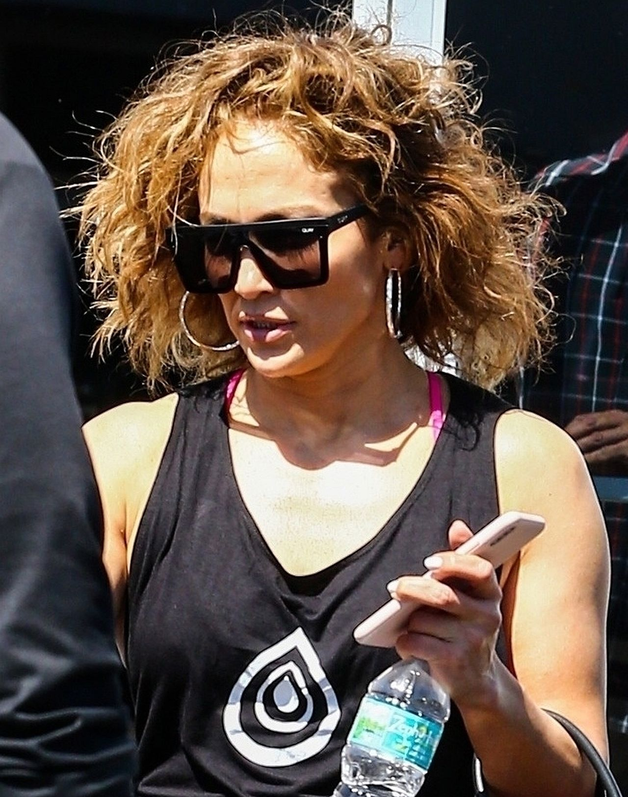*EXCLUSIVE* Jennifer Lopez sports a curly new hairstyle while leaving the gym Jennifer Lopez