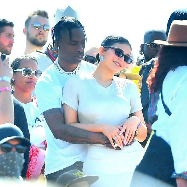 Travis Scott and Kylie Jenner show lots of PDA while watching Kanye West perform his 'Church Sunday Services' at Coachella in Indio, CA.