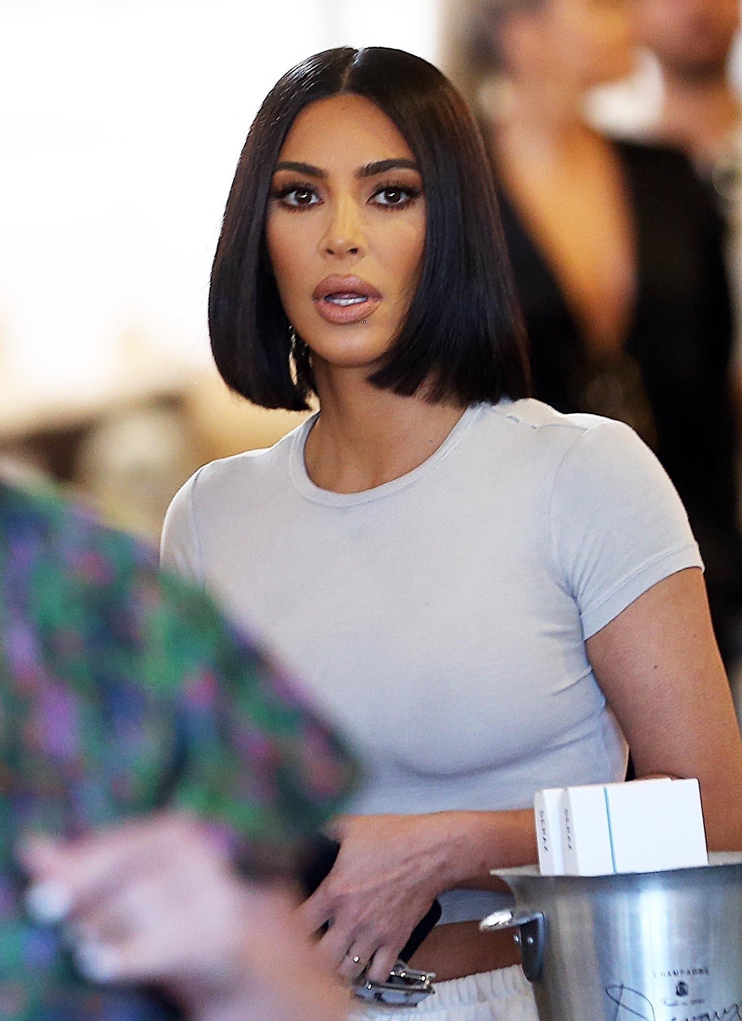 *EXCLUSIVE* Kim and Khloe Kardashian depart after lunch with Scott Disick for KUWTK Kim Kardashian
