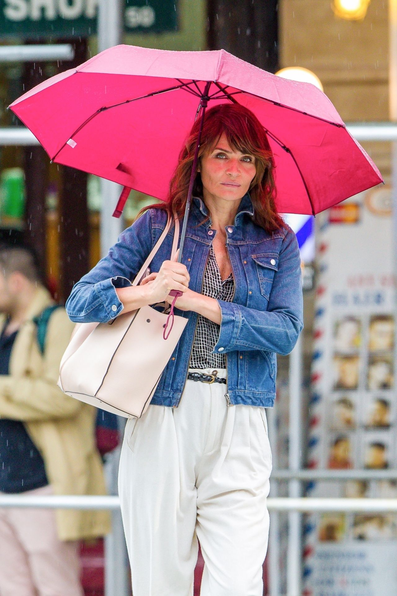 *EXCLUSIVE* Helena Christensen sports a bright pink umbrella on a rainy New York afternoon Helena Christensen