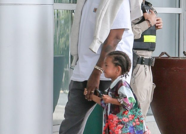 *EXCLUSIVE* Kim appears to have the post-vacation blues as she heads to the airport with her family