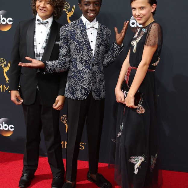 "Actors Gaten Matarazzo, Caleb McLaughlin and Millie Bobby Brown from the Netflix series ""Stranger Things"" arrive at the 68th Primetime Emmy Awards in Los Angeles, California"