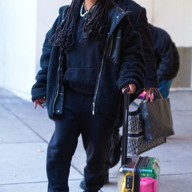 *EXCLUSIVE* Rihanna makes a fashionable arrival at JFK airport in NYC